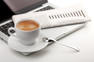 Laptop, newspaper and cappuccino