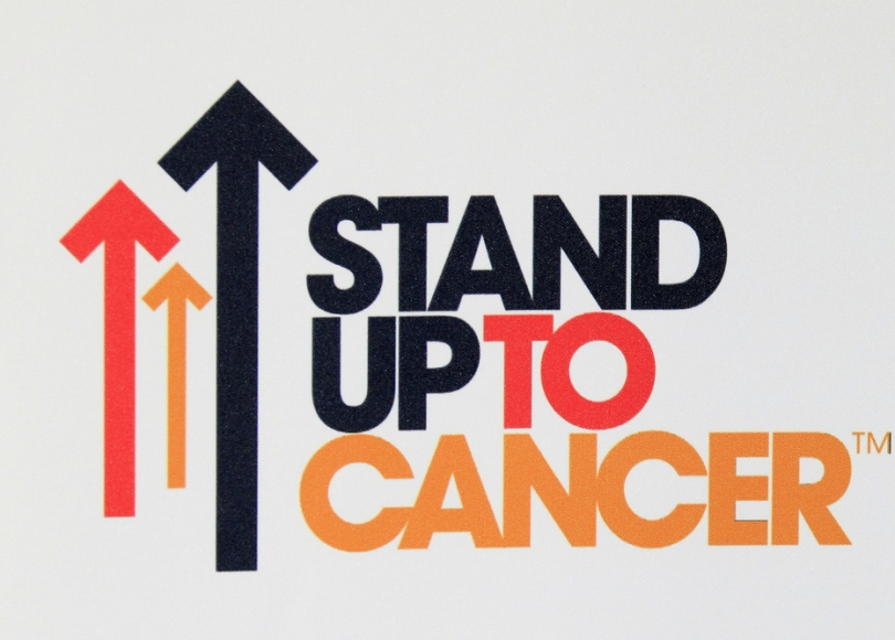 Stand Up To Cancer logo represents an organization that is working to accelerate progress against cancer